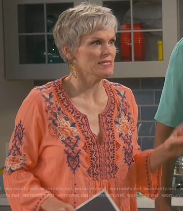 Bonnie's orange floral embroidered top on Happy Together