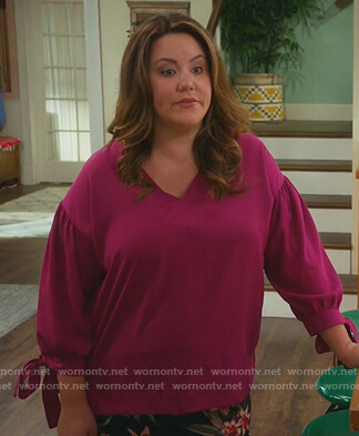 Katie's pink tie sleeve blouse on American Housewife