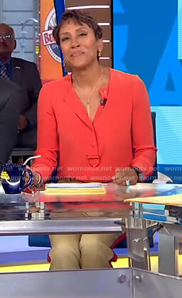 Robin's orange blouse and side striped pants on Good Morning America