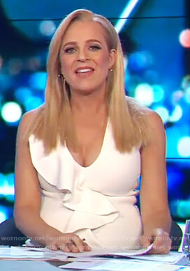 Carrie's white ruffle front dress on The Project