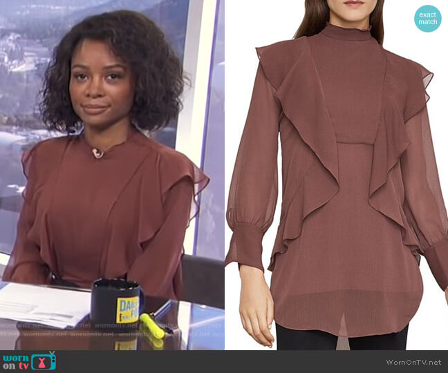 Ruffle-Trim Tunic Blouse by Bcbgmaxazria worn by Zuri Hall  on E! News