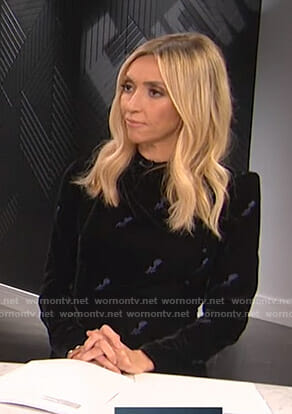 Giuliana's black velvet mini dress on E! News
