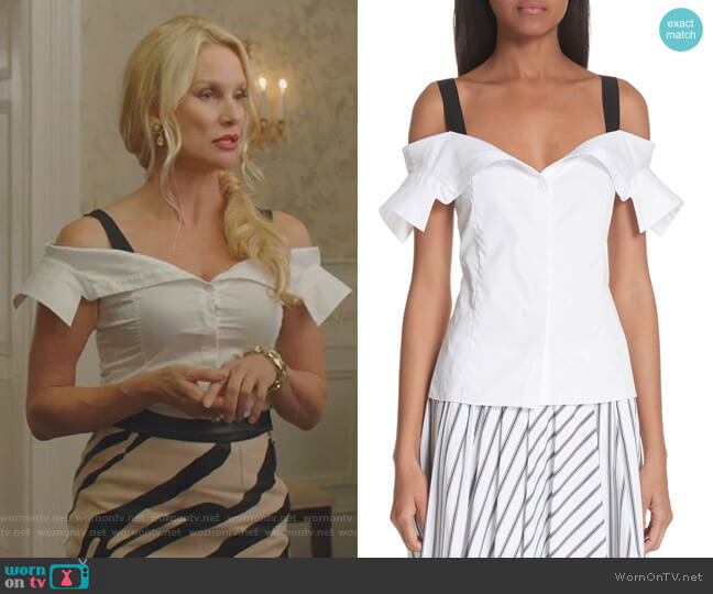 Alexis's white off-shoulder top and zebra print skirt on Dynasty