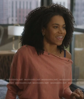 Maggie's pink buttoned sleeve sweater on Grey's Anatomy