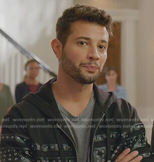 Sam's grey paint splatter tee and eyelet zipped hoodie on Dynasty