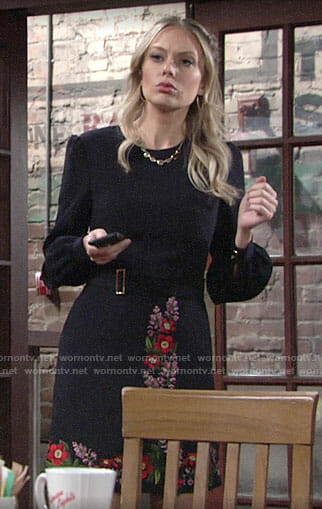 Abby's navy dress with floral embroidery on The Young and the Restless
