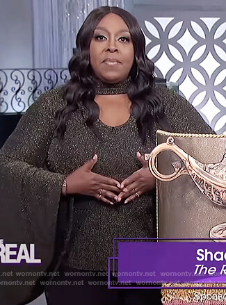 Loni's black metallic bell sleeve top on The Real