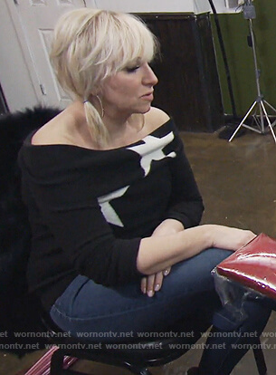Margaret's black star off shoulder sweater on The Real Housewives of New Jersey