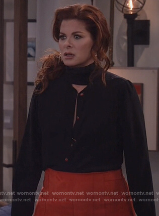 Grace's black tie neck blouse and red suede skirt on Will and Grace