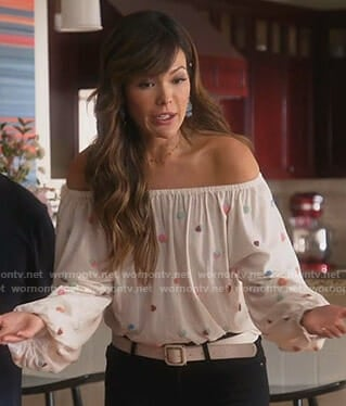Camille's white off-shoulder top on Splitting Up Together