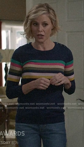 Claire's rainbow striped sweater on Modern Family