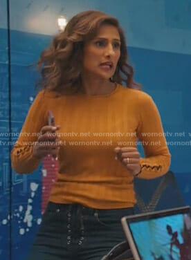 Emet's orange ribbed button sleeve sweater on I Feel Bad