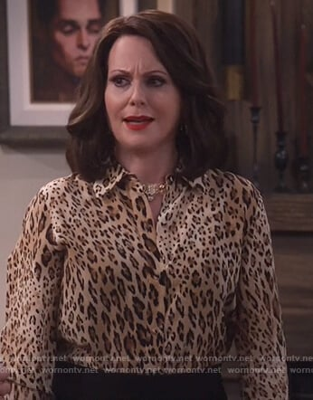 Karen's leopard print blouse and black side zip skirt on Will and Grace