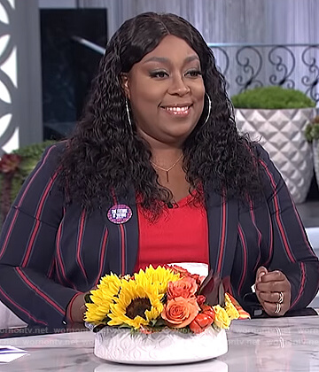 Loni's navy striped blazer on The Real