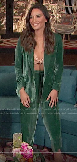 Olivia Munn's green velvet suit on Busy Tonight