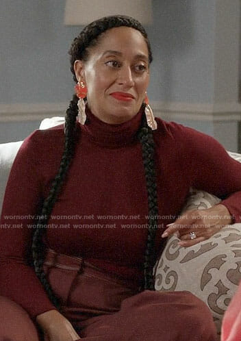 Bo's burgundy turtleneck and orange earrings on Black-ish
