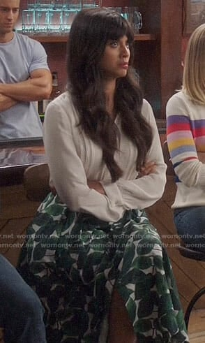 Tahani's leaf print skirt and white blouse on The Good Place