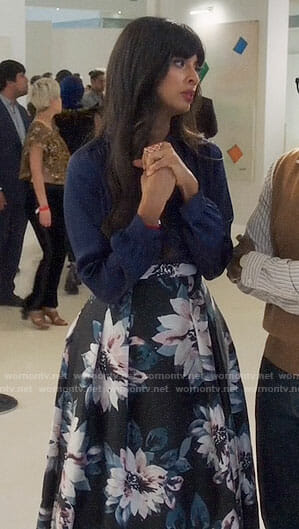 Tahani's navy blouse and floral high-low skirt on The Good Place