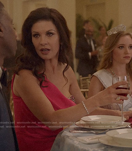 Vicki's pink embellished one-shoulder gown on Queen America