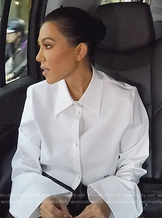 Kourtney's white bell sleeve cropped top on Keeping Up with the Kardashians