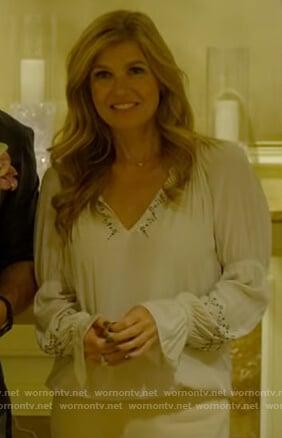 Debra's white v-neck embellished top on Dirty John