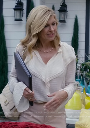 Debra's white sheer ruffle blouse on Dirty John