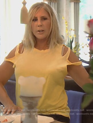 Vicki's yellow sleeve cutouts tee on The Real Housewives of Orange County