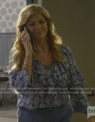 Debra's printed ruffled blouse on Dirty John