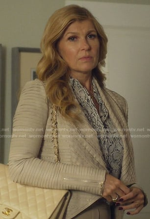 Debra's snake print blouse and studded draped jacket on Dirty John