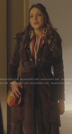 Fallon's brown corduroy coat and white zip front dress on Dynasty
