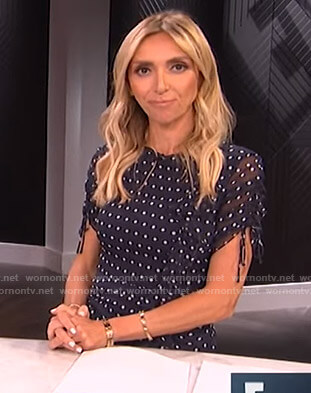 Giuliana's navy polka dot ruffled dress on E! News