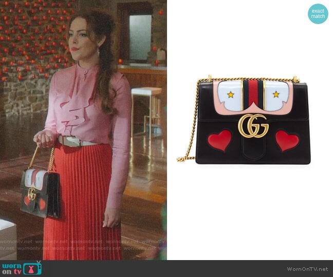 GG Marmont Medium Web Heart Shoulder Bag by Gucci worn by Fallon Carrington (Elizabeth Gillies) on Dynasty