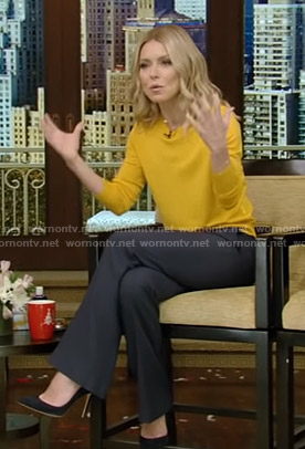 Kelly's yellow sweater and button front pants on Live with Kelly and Ryan