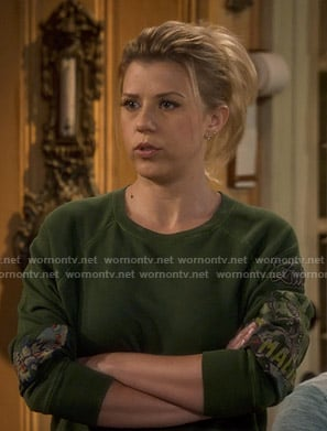 Stephanie's green embroidered sweatshirt on Fuller House