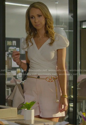 Veronica's white short sleeve wrap top and pink shorts on Dirty John