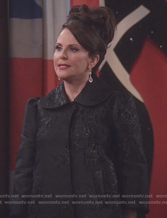 Karen's black puff shoulder metallic jacket on Will and Grace