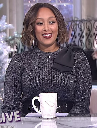 Tamera's black metallic bow shoulder sweater on The Real