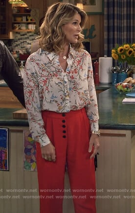 Rebecca's white floral print blouse and red cropped pants on Fuller House