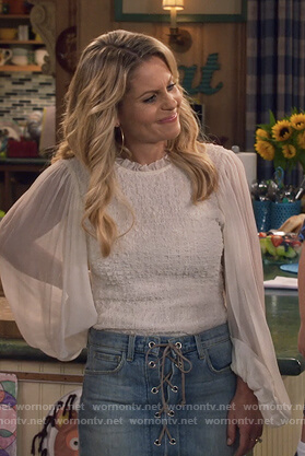 DJ's white sheer sleeve blouse and lace up denim skirt on Fuller House