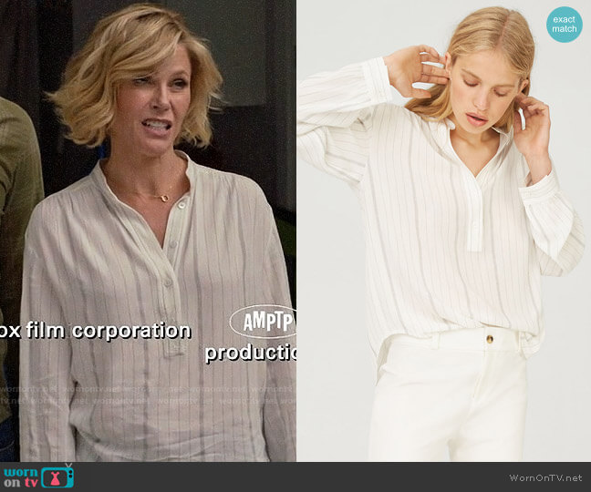 Club Monaco Maira Shirt worn by Claire Dunphy (Julie Bowen) on Modern Family