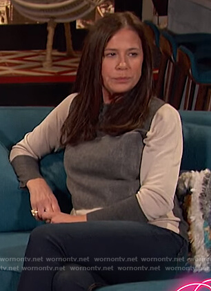 Maura Tierney's colorblock sweater on Busy Tonight