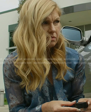 Debra's blue floral tie neck blouse on Dirty John