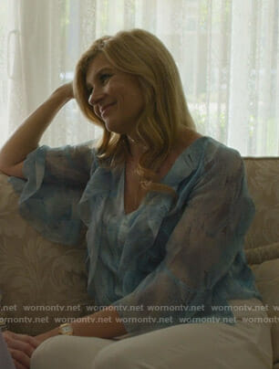 Debra's blue printed ruffled top on Dirty John