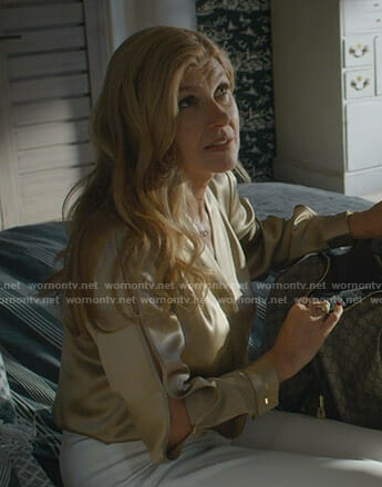 Debra's gold split sleeve top on Dirty John