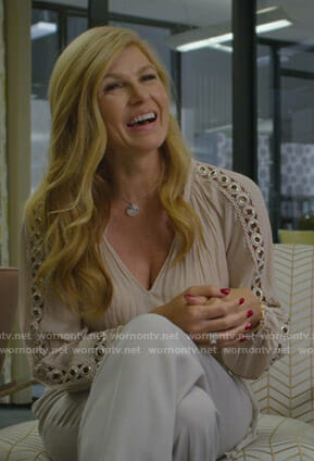 Debra's pink grommet embellished blouse on Dirty John