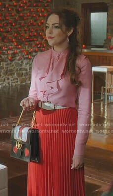 Fallon's pink ruffled blouse and red pleated skirt on Dynasty