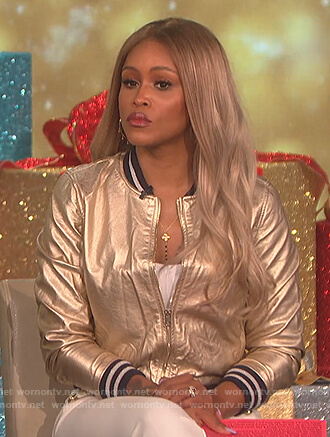 Eve's gold metallic bomber jacket and white button detail pants on The Talk