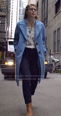 Kara's floral shirt and blue coat on Arrow
