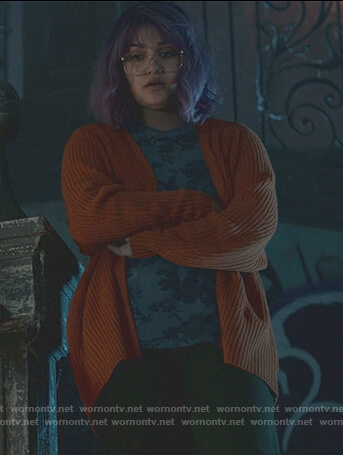 Gert's orange knit cardigan on Marvels Runaways