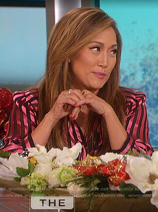 Carrie's pink satin striped blouse on The Talk